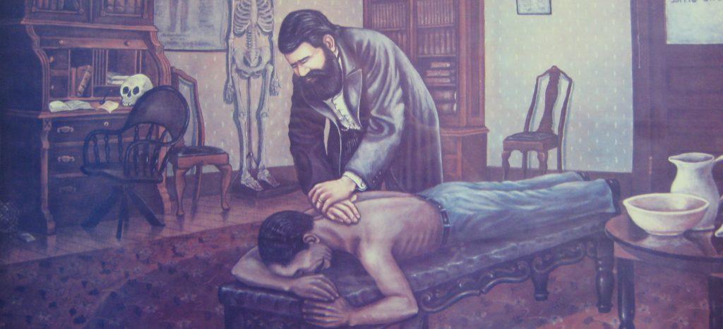 Older picture of chiropractor adjusting patient